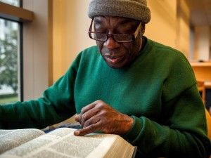Langston Sylvester reads about Elijah Muhammad in The African American Almanac at the Sacramento Public Library. Sylvester visited the library each day during Black History Month to study the lives of notable African Americans.